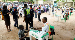 PIC. 4. A PHYSICALLY CHALLENGED VOTER BEING ACCREDITED AT GARKI PRIMARY SCHOOL   POLLING UNIT IN ABUJA ON SATURDAY (28/3/15). 1653/28/3/2015/ZI/BJO/NAN