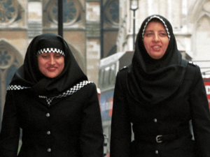 white police offer in hijab