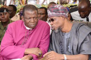 Governor Rauf Aregbesola and the  Primate of the Church of Nigeria ( Anglican Communion) Most Reverend Nicholas Okoh at the commissioning of the Bisi Akande block, Evangel College, Otan-Ayegbaju, Osun State.