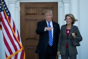(FILES) This file photo taken on November 18, 2016 shows president-elect Donald Trump and Betsy DeVos after their meeting at Trump International Golf Club, in Bedminster Township, New Jersey.  US President-elect Donald Trump announced November 23, 2016 that he intends to nominate Betsy DeVos, a wealthy Republican campaigner for alternatives to public schools, as his education secretary.DeVos is the second woman Trump has tapped to fill a cabinet position. He earlier named South Carolina Governor Nikki Haley to be US ambassador to the United Nations.  / AFP PHOTO / GETTY IMAGES NORTH AMERICA / Drew Angerer