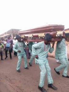 Funeral Undertakers carrying Mama Casket
