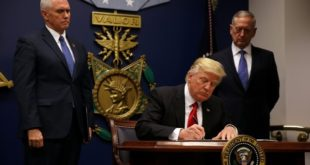 President Trump signing the order banning Syrian refugess and citizens of other seven countries from United States on Friday.