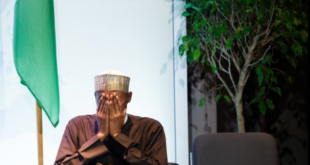 buhari covers face