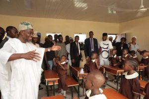 Aregbesola dancing with pupils