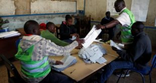 Election officials count ballot papers during Kenya's presidential election in Nairobi