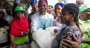 Aregbesola Carrying Baby