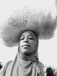 Bashirat Ajao, the Chief Executive Officer, Natural Skincare Line Sisi Herfrican with her load on her head.
